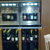 These machines are from NapaTechnology (there's a website) and are called the Winestation.