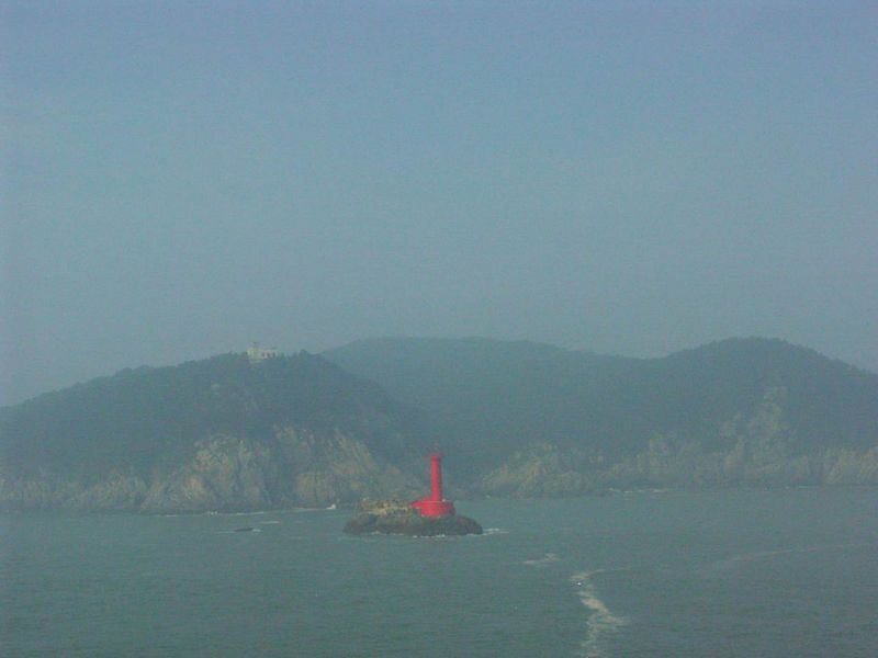 As the fog gradually thinned, a lighthouse became visible.