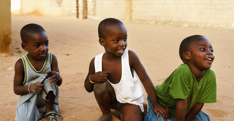 Three Senegalese kids playing