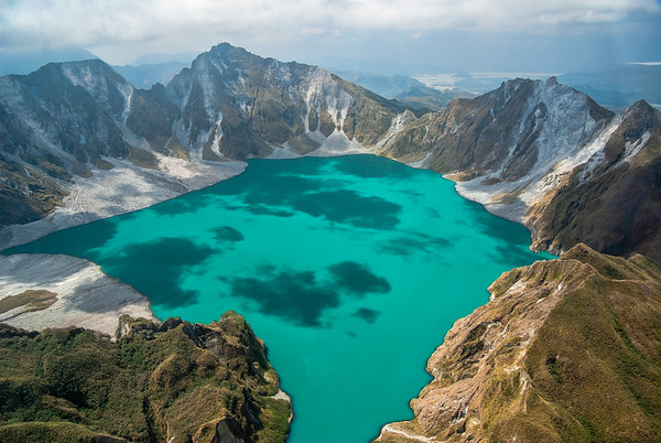 In 1991, the eruption of the Pinatubo volcano killed 800 people and released 20 millions tons of sulfur dioxide in the atmosphere, resulting in a worlwide decrease of the temperature in the following years.   The eruption led to the creation of a 2.6 km wide caldera, pictured above. The surrounding landscape was completely knocked over, and the Pinatubo summit lost 260 metres and stands now at 1,485m above see level.