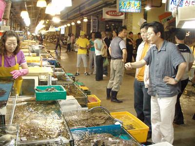 Gap and his cousin at the Seoul Fish Market