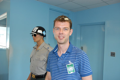 Frederick in the UN building in the Korean Demilitarized Zone. The door in the background leads to North Korea. The South Korean soldier is there to protect visitors to the Joint Security Area.