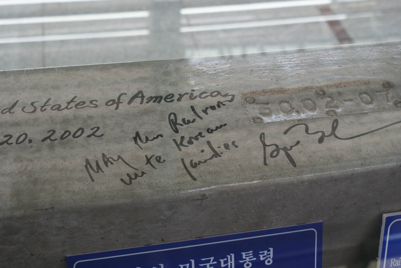 "George W. Bush visited the DMZ in 2002 and graffitied a banister.  Honestly - he writes, ""May the railroad unite Korean families."""