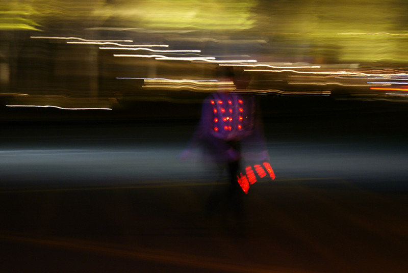 I like this picture of a traffic guard at night.