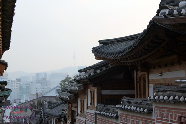 Old school architecture in Seoul's Hanok Village with a glimpse of modernity in the background