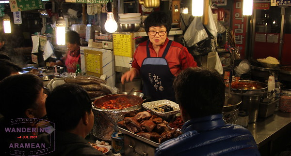One of the many proprietors working her booth at the Gwangjang Night Market