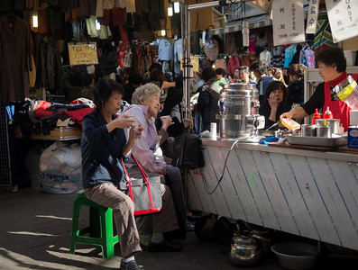 Enjoying a meal at Namdaemun market.