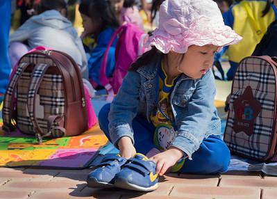 Arranging her shoes for a picnic. Korean War Memorial