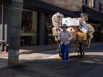 Woman and cart. Near Korea University.