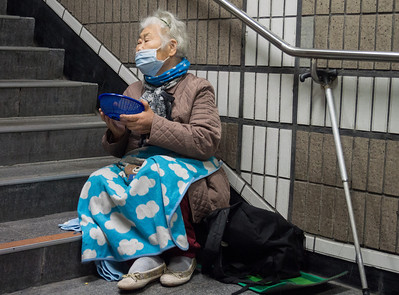 Seto emphatized with this woman begging at a subway station. Life is difficult for the displaced.