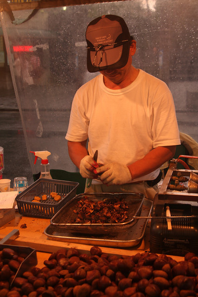 Roasting (and peeling) chestnuts. Just like in NYC! (they don't peel them there though.)