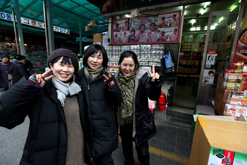 After passing their shop a few times, I had these woman pose for a photo.