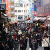 A market in downtown Seoul is bustling with holiday shoppers.