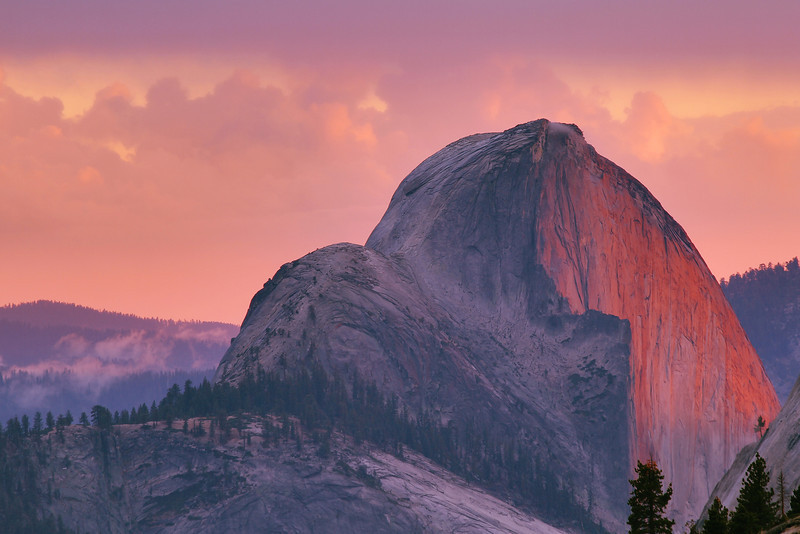 Half Dome in Yosemite National Park at sunset, from Olmsted Point.  Exposure fused from a bracket set.  I had tried this the previous night, but had some problems.  I went back up the next evening, but it was socked in when I got there.  I don't give up *that* quickly, though, and was rewarded for my patience.