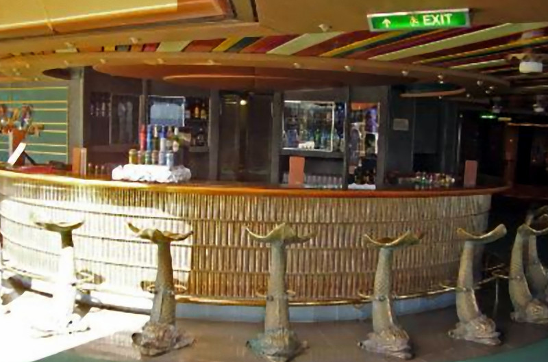 The Lido Pool bar...one of 6 or 7 bars aboard the ship. (Beyond Ships file photo.)