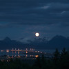 Summer rising moon over Homer AK.