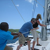 Raising the main sail with our friendly skipper, Andre.  Once we passed his test, he turned us loose for the week.