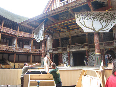The Globe stage crew preparing for the night's performance.  The Mistrals' Gallery in the centre on the first floor is in constant use as there is live music for all performances as there would have been 'back in the day'.