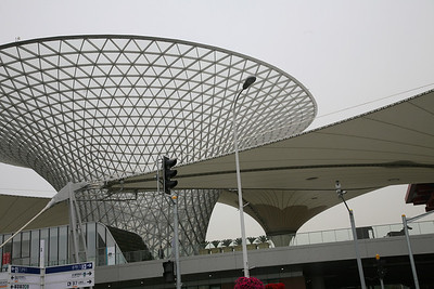 Expo Axis, Shanghai World Expo 2010  The Expo Axis is one of the world's largest membrane roofs. It spans the entrance and boulevard building of the World Exposition 2010 in Shanghai. The combination of the membrane structure, which has a surface of 65,000 m2 in total with a span of 100 m, and the six steelglass funnels of 45 m height, formed of a freeform double-curved framework, constitutes the landmark of the Expo Shanghai 2010.