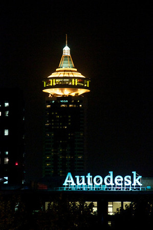 The Autodesk office at night, lit up from behind with one of the many towers in Shanghai.