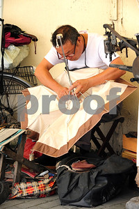 August 2010-Shanghai, China- The people in Shanghai, China, find a way to carry on with temperatures in excess of 108 degrees and heavy humidity.   An embrella maker and repair man working on the street.  Photo by SMP   ZUMA Press