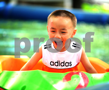 August 2010-Shanghai, China- The people in Shanghai, China, find a way to carry on with temperatures in excess of 108 degrees and heavy humidity. A young boy plays in mini paddle boat on a pond in People's Park.    Photo by SMP   ZUMA Press