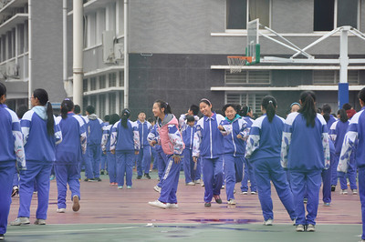 Beijing middle school students doing morning exercises, and listening to the daily political speech