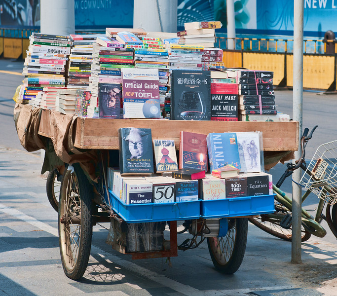 Western journalists like to highlight China's censorship activities, but take a look at this Shanghai roadside bookseller- everything from Warren Buffet, Jack Welch and even two bibles clearly visible.