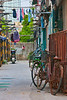 A typical scene in Shanghai's French Concession old quarter.  Despite great leaps forward, the bicycle is still a very common mode of transport here.