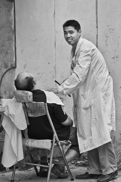 It is still possible to find men getting a straight razor shave or haircut on the street side in certain parts of Shanghai.