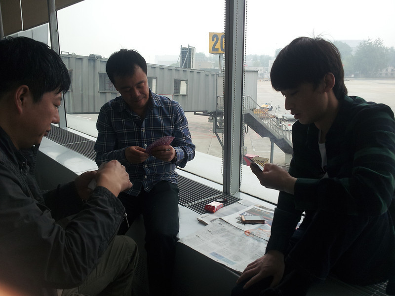 Chinese gambling in the airport smoking room