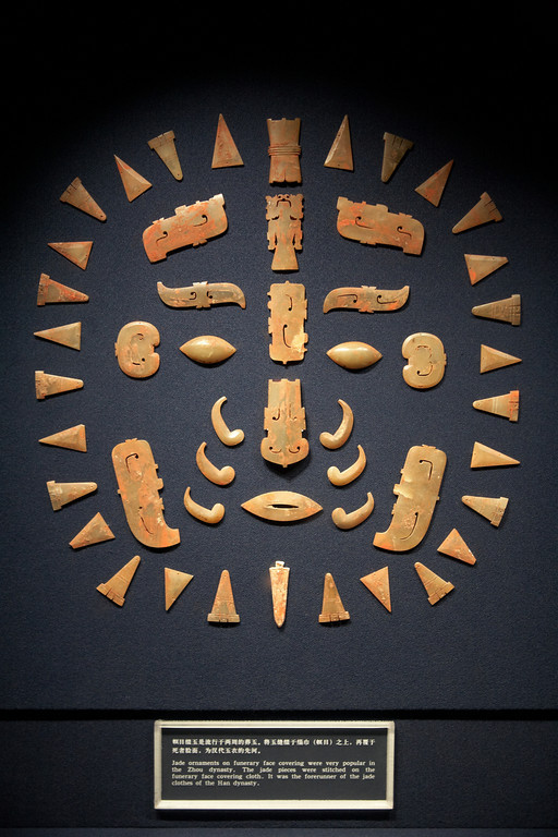 Jade ornaments from the Zhou Dynasty that were sewn to a cloth draped over a cloth for covering a dead person's face.