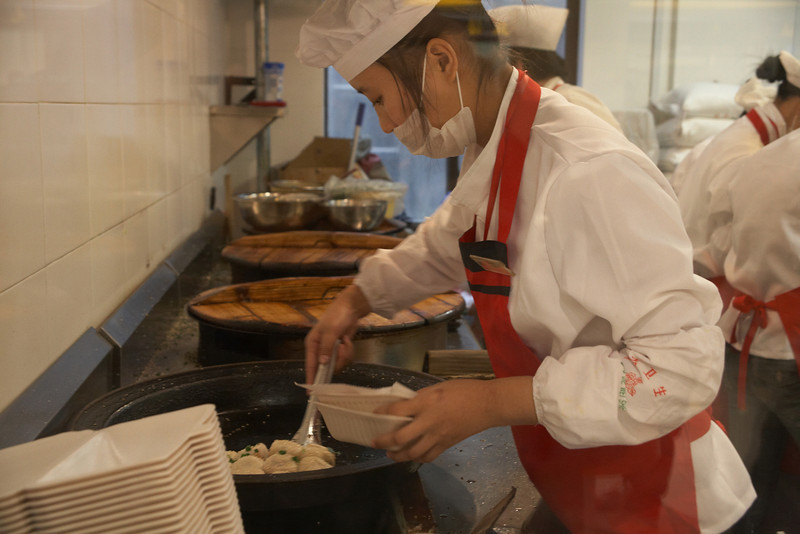 Making deep fried soup buns (小杨生煎), a Shanghaiese specialty. We miss it already.