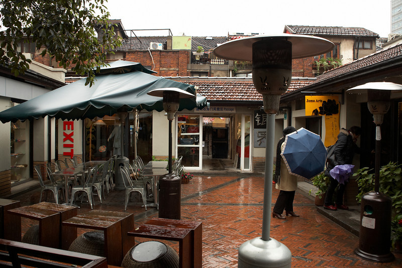 A cold rainy day in Tian Zi Fang. On this street, you will find many private art studios that host both modern art and local folk culture - including ornaments and handcrafts. This street is also filled with restaurants and bars.