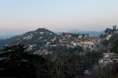 Evening view of Shimla. Shimla is the capital city of the Indian state of Himachal Pradesh, located in northern India at an elevation of 7,200 ft. Due to its weather and view it attracts many tourists. It is also the former capital of the British Raj.