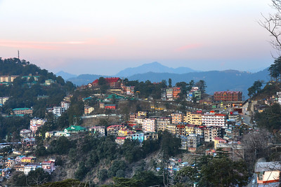 Beautiful view from The Mall Road, Shimla. Shimla is the capital city of the Indian state of Himachal Pradesh, located in northern India at an elevation of 7,200 ft. Due to its weather and view it attracts many tourists. It is also the former capital of the British Raj.