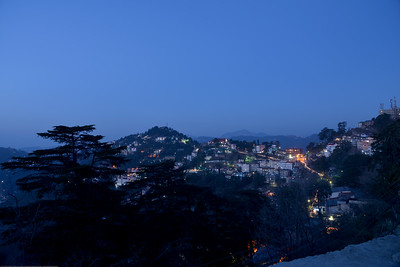 Late evening view at The Mall Road. Shimla is the capital city of the Indian state of Himachal Pradesh, located in northern India at an elevation of 7,200 ft. Due to its weather and view it attracts many tourists. It is also the former capital of the British Raj.