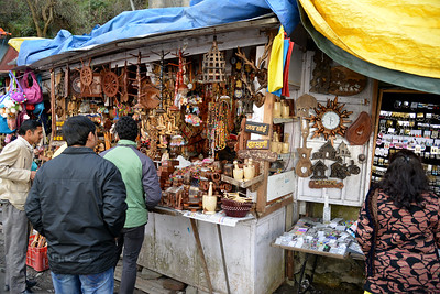 Street shopping at The Mall Road, Shimla.  Shimla is the capital city of the Indian state of Himachal Pradesh, located in northern India at an elevation of 7,200 ft. Due to its weather and view it attracts many tourists. It is also the former capital of the British Raj.