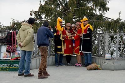Tourists dress in local traditional cloths for a picture. Shimla is the capital city of the Indian state of Himachal Pradesh, located in northern India at an elevation of 7,200 ft. Due to its weather and view it attracts many tourists. It is also the former capital of the British Raj.