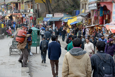 Street view. Shimla is the capital city of the Indian state of Himachal Pradesh, located in northern India at an elevation of 7,200 ft. Due to its weather and view it attracts many tourists. It is also the former capital of the British Raj.