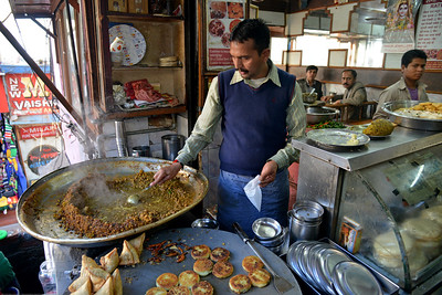 Hot chola, samosa and patties in the market at Shimla. Shimla is the capital city of the Indian state of Himachal Pradesh, located in northern India at an elevation of 7,200 ft. Due to its weather and view it attracts many tourists. It is also the former capital of the British Raj.