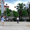 Susan Wei plays basketball in a village.