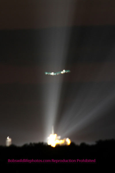 a plane flying between us and the launch complex. Or was it? dum dum dum dum