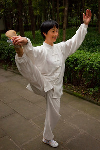"Local teacher ""limbering"" up prior to class at Wenshu Temple"