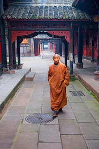 Monk walking in morning at the Wenshu Temple in Chengdu