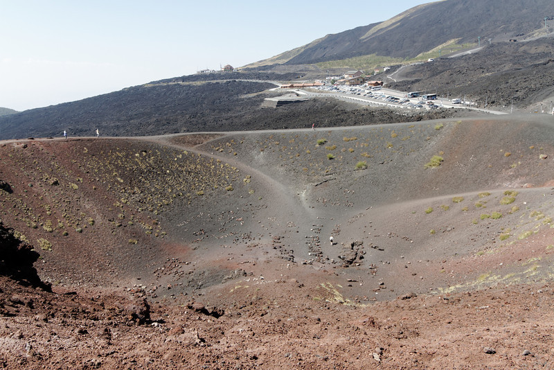 Mt. Etna - this view of one of the craters shows the large parking lot area in the background.  The Cable Car that goes to the top of the mountain is at the back right of the photo.