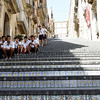 "Caltagirone - these are some of the spectacular stairs of the 142 steps of the Scalinata di Santa Maria del Monte, which connects the lower town with the old upper town.  The vertical part of each step is covered with ceramic tiles, which provides a very colourful contrast to ""normal"" stairs.  A local Soccer team was taking a break from the sun at the time this was taken."