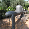 "Taormina - This was displayed in the Botanical Gardens, and is a piloted underwater vehicle resembling a Torpedo.  These were basically a slow speed vehicle guided to their target by a two Divers.  These were officially termed a ""Siluro a Lenta Corsa"", but were more frequently referred to as a maiale (Italian for ""pig"") as they were difficult to steer.  The Italian Navy used them during WW-II with some success for sabotage.  The pilot would guide the craft underneath a warship, start the timer, drop the warhead and then escape which was a similar tactic to using a Limpet Mine.  The explosion under the ship would usually break the keel, causing the ship to sink fairly quickly."