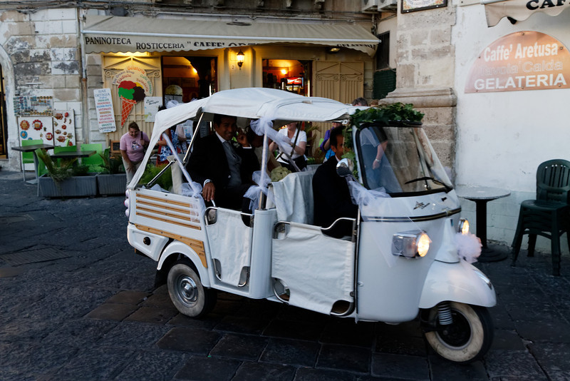 Syracuse - this unusual vehicle was being used for a wedding. The Bride & Groom are somewhat visible in the back.