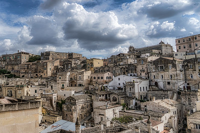 View of Matera Sassi from the terrace in front of hotel room in one of the cave hotels.